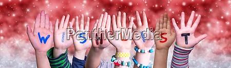 children hands building word wishlist red