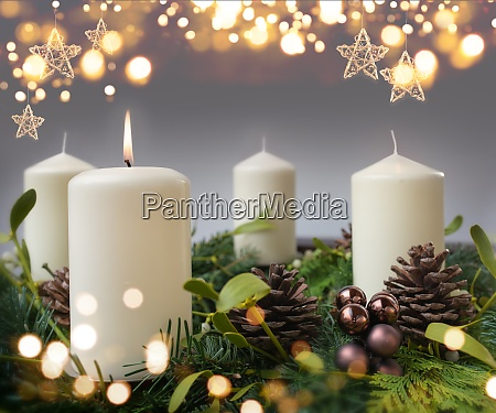 one burning candle in advent season