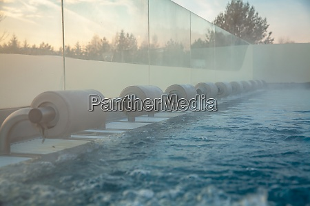 outdoor pool with water massage for