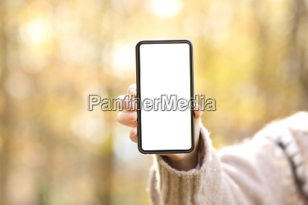 woman hand showing blank smart phone