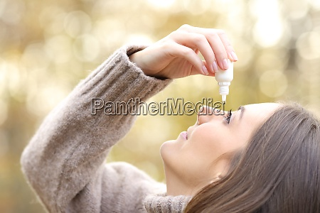 woman with dry eyes applying artificial