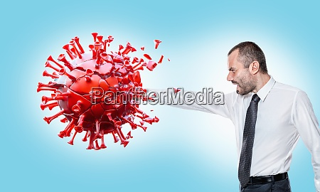 man punches covid 19 virus