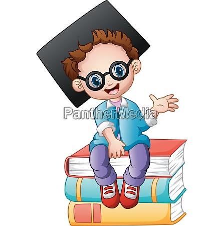 graduation boy sitting on piles of