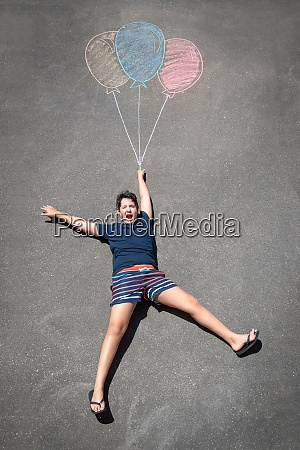 boy and balloons