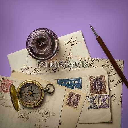 antique ink well and old letters
