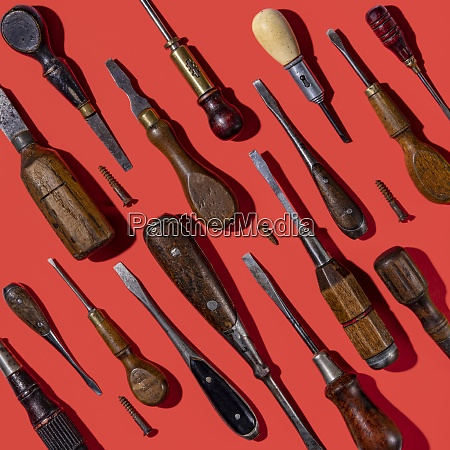 vintage screwdrivers on red background