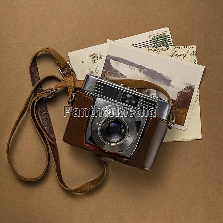 retro amateur 35mm camera with postcards