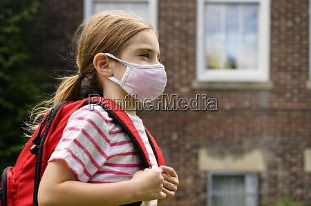 schoolgirl 6 7 wearing flu mask