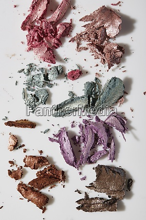 crushed colorful eye shadows on white