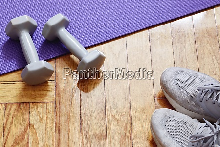 weights yoga mat and running shoes