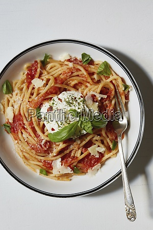 spaghetti with tomato sauce on plate