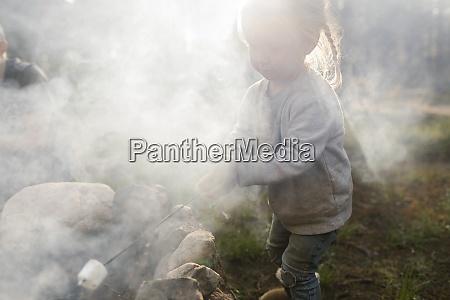 girl 2 3 roasting marshmallow over