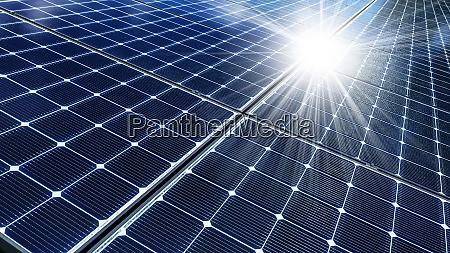 close up of solar panels reflecting
