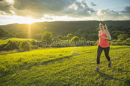 usa woman running in field