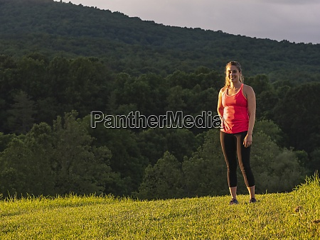 usa woman in running outfit standing