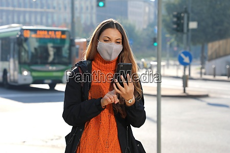young business woman with protective mask