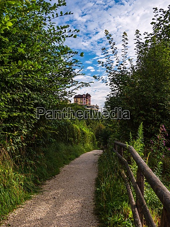 footpath with trees and building in