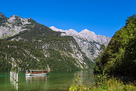 lake koenigssee with rocks and excursion