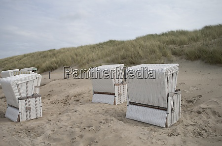 beach chairs in sand