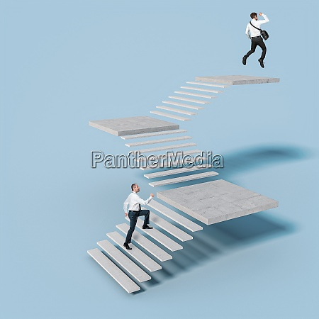 businesspeople climb the stairs leading to