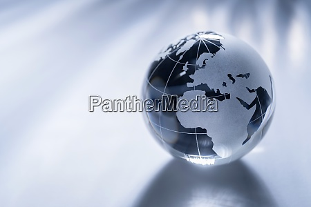 glass globe on gray background
