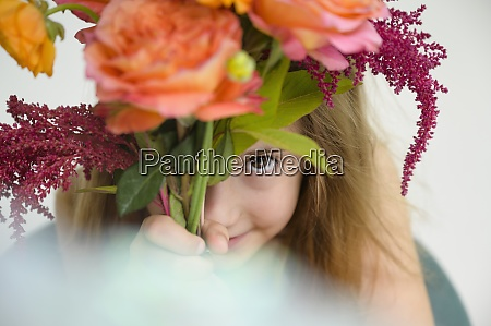 girl 6 7 holding flower bouquet