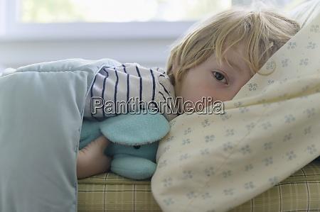 boy 4 5 lying in bed