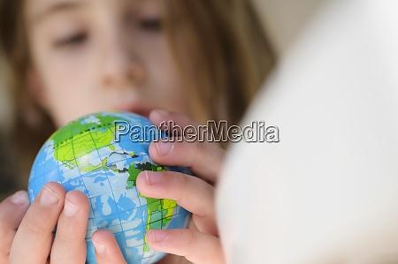 girl 6 7 holding globe