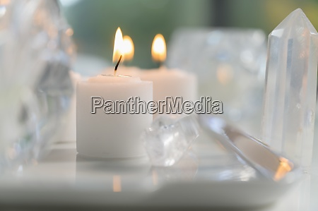 composition of burning candles and crystals