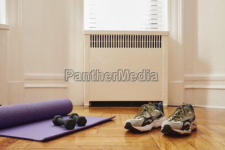 yoga mat weights and sports shoes