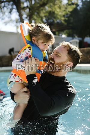 father playing with toddler daughter 2
