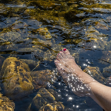 womans foot in river