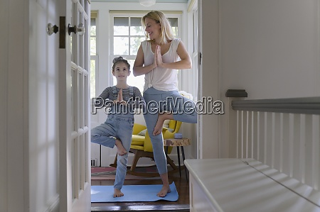 mother, with, daughter, (6-7), practicing, yoga - 29034130