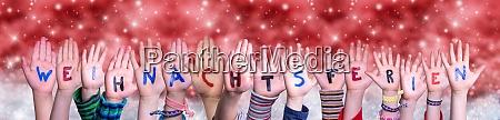 children hands weihnachtsferien means christmas break