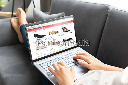 woman online ecommerce shopping using laptop