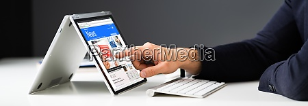 read online news media on laptop