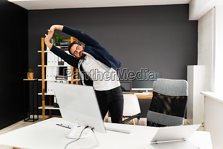 exercise stretch standing near office desk