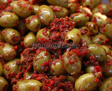 pickled green olives with tomato on