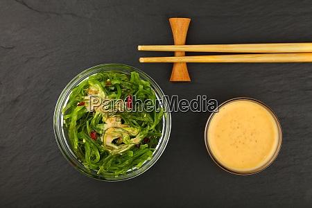 green wakame seaweed salad with satay