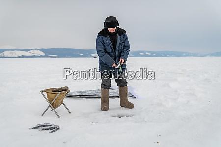 fisherman on the baikal lake in