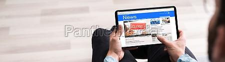 watching news on computer screen online