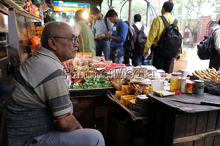 street vendor in stall along a