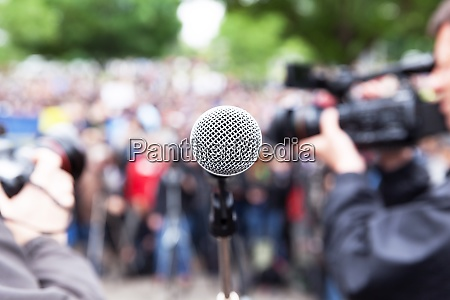 microphone in focus at street protest
