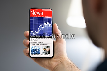 man using smartphone reading electronic news