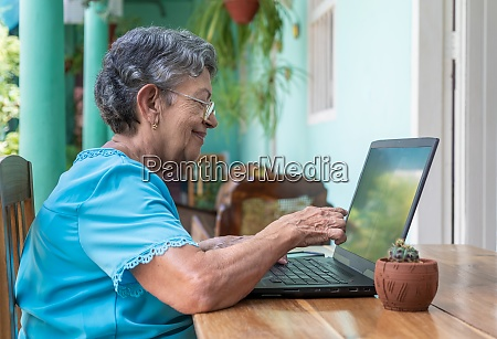 elderly woman working with a modern