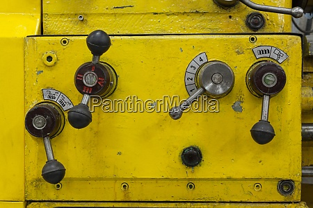 old yellow lathe machine with a