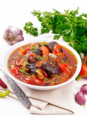 ragout vegetable with eggplant on wooden