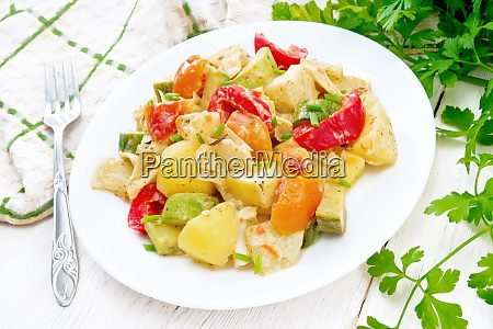 ragout vegetable with zucchini on wooden