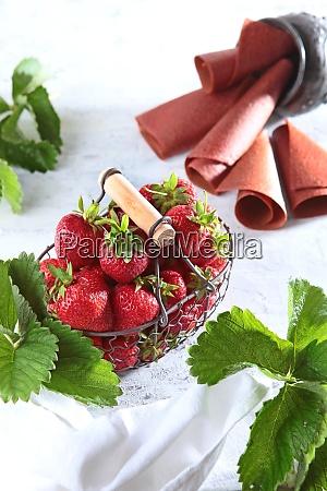 strawberries in a wicker metal basket