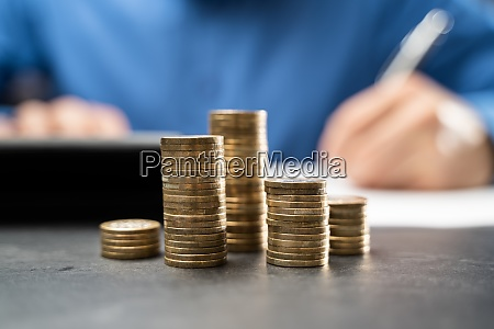 income tax and saving money coins